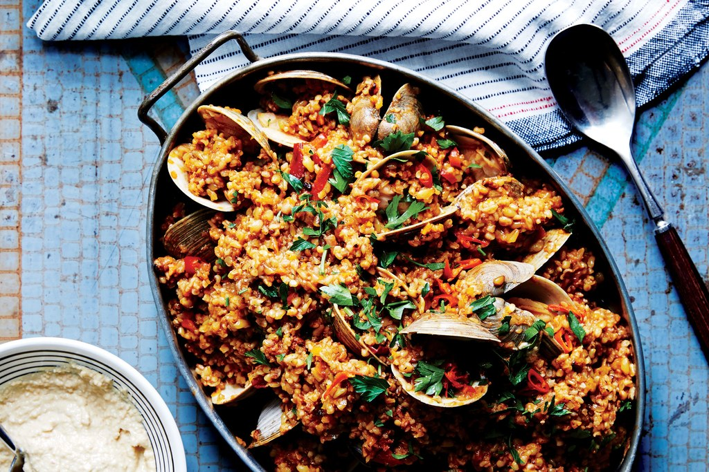 Freekehas Paella with Clams and Almond Aioli